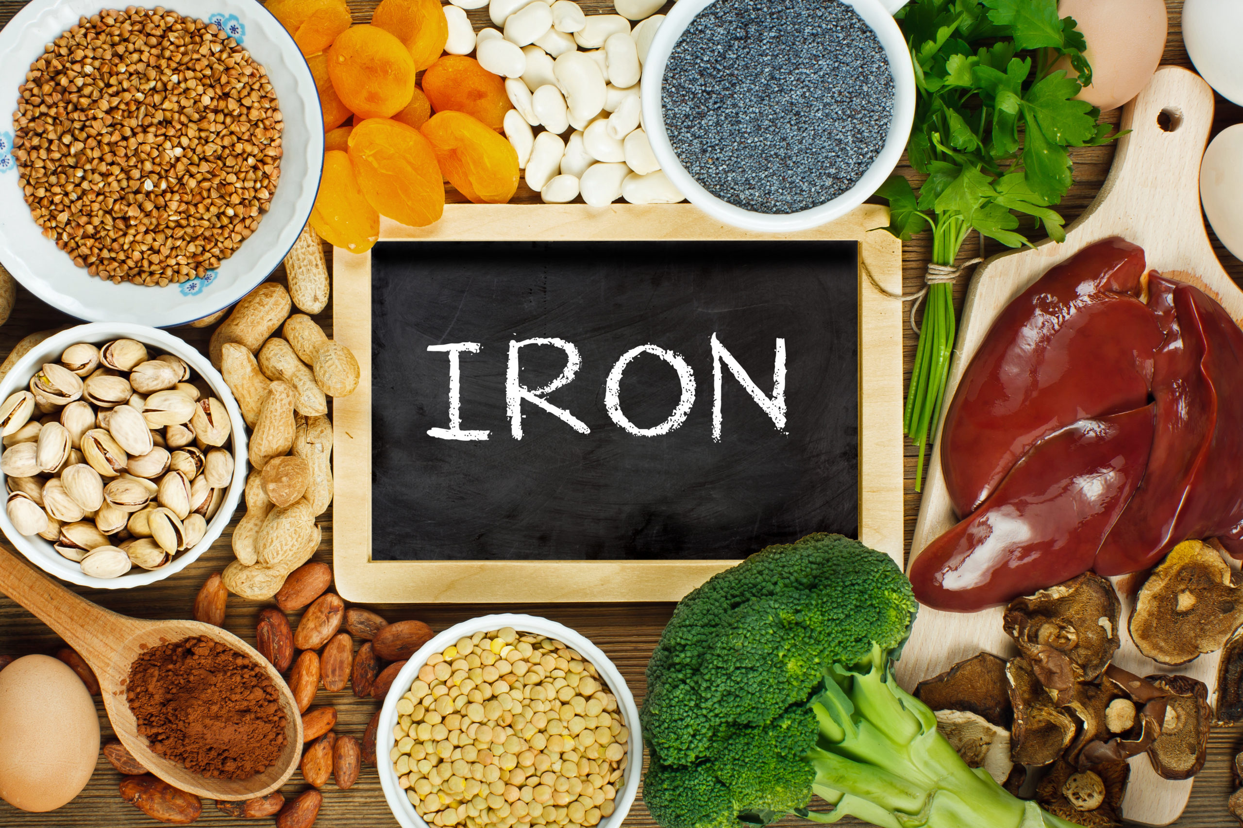 A selection of foods on the table with a sign that reads iron